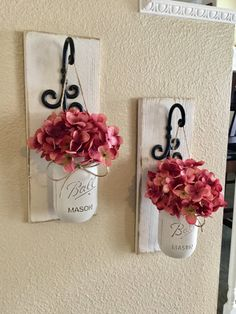 These rustic country style mason jar sconces are the perfect touch to your home decor. They bring warmth and beauty to any room. This listing is for 2 Sconces so for each quantity of one at checkout you are ordering one set of 2.  Scroll through the listing to see your sconce finish/flower/jar paint color options. The Sconce pictured is done in Antique White the Jars are done in Antique White and the flower is Rose Pink. (Flowers are optional)  {Please Leave Me a Note At Checkout Wi...