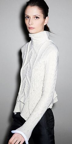 asymmetrical chic white turtle neck sweater