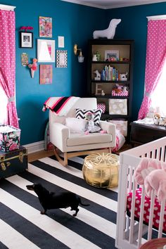 Love the idea of a deep masculine blue, paired with lipstick pink in a girls nursery!