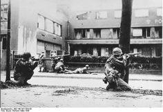Soldiers of 44th Division US 7th Army fighting in Mannheim Germany 29 Mar 1945; note bazooka and M1 Garand rifles