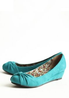 turquoise flats with a heal