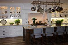 Like the x glass cabinet design. Fabulous pot rack too!