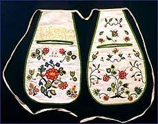 Art c1720, Embroidered in brightly colored wool yarns, this pair of linen pockets carries the date of their manufacture and the initials of their owner, E.B. 15 high x 9 wide, Smithsonian 18th-century-accessories