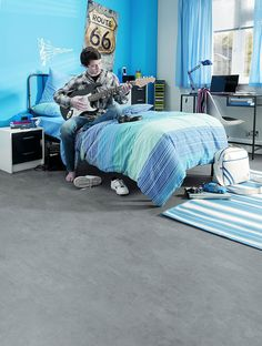 Bedroom featuring Secura PUR luxury vinyl sheet flooring in Polished Concrete
