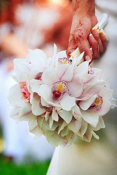Hand tied cymbidium orchid bouquet. By A Regal Affair.