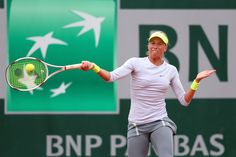 Andrea Hlavackova of Czech Republic plays a forehand in her Women's Singles match against Anastasia Pavlyuchenkova of Russia during day one of the French Open at Roland Garros on May 26, 2013 in Paris, France.