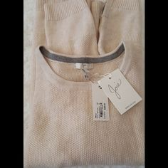 Joie Cashmere and Wool Sweater This soft luxurious cashmere blend sweater is such a stable item, with cute subtle detail at hem. Cream in color. Size large but if you are small you can definitely wear this as an oversized sweater. Joie Sweaters