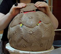 Ceramic sculpture Coccolithospores by Michelle Maher. The piece was inspired by a microscopic algae organisms the Coccolithospore & was hand built by overlapping paper clay patches. See www.ceramicforms.com for details on all my pieces.