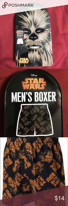 "Disney's Chewbacca Star Wars Men's Boxers Star Wars I Did It All For the Wookiee Men's Boxers in a Tin  New Chewbacca men's boxers in Disney collector tin!  Keep your favorite Star Wars character close to you with this officially licensed Chewbacca boxers! These 100% cotton boxers feature a screen-printed graphic of Chewbacca with the phrase ""I did it all for the Wookiee"". Licensed by Briefly Stated, Comes in a quality tin container! BX4. 100% Cotton - Small 28-30"" Waist, Medium 32-34""…"