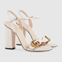 Shop the Leather sandal by Gucci. The Double G gold-toned hardware is set on the strap of these high-heel leather sandals. Dr Shoes, Cute Shoes, Golf Shoes, Shoes Sneakers, Shoes Valentino, White Gucci Shoes, White High Heels, Discount Designer Shoes, Fashion Shoes