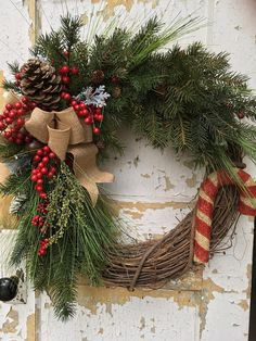 Christmas Wreath, Candy Cane Wreath, Rustic Holiday Wreath, Etsy Christmas Wreath This festive Christmas wreath will bring warmth and good cheer to your front door. It is filled with lovely quality evergreen boughs, greens, red berries, pine cones, a burlap bow, a Rustic Christmas