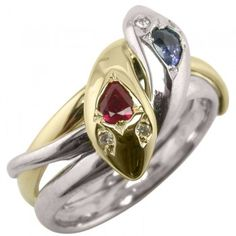 Entwined Snake Ring in Platinum and Yellow Gold. This dramatic snake ring features a platinum snake with a sapphire, and a yellow gold snake with a ruby that are gently intertwined. Diamond Eyes, Snake Ring, Snake Jewelry, Beaded Jewelry, Unusual Rings, Blue Rings, Diamond Wedding Rings, Eternity Ring, Wedding Jewelry