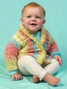 Free Knitting Pattern Cuddle Up Baby Cardigan in super bulky yarn - Need a quick baby shower gift? This cowl collared cardigan sweater by Lorna Miser for Red Heart is an easy-to-knit gift for a special baby. Sizes 6 months to 24 months. Great with multi-color yarn
