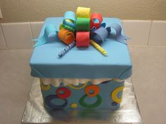 Gift box cake all rainbow inside and out