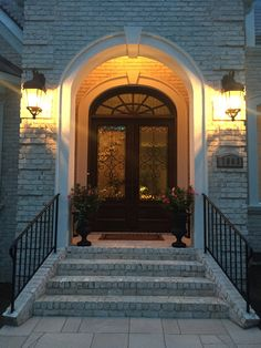 The luminescent white of Chesapeake Pearl  brick glows in the early evening light and looks great matched with a  mahogany door with lunar panes. Chesapeake Pearl  Ovesize Tumbled is the exterior brick color and is made by Pine Hall Brick.