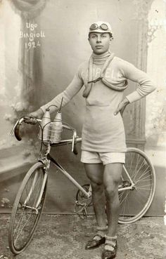Ugo Biagioli 1924...Proper cycling clobber, goggles, pop, comfy shorts and a length of animal intestines about the shoulders! Last one to the top's a wuss!