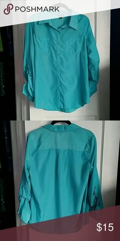 George Turquoise Button Down Shirt Beautiful turquoise color. Great shirt for work; has button on sleeves to roll them up. 100% polyester. George Tops Button Down Shirts