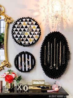 """This jewelry display is what DIY dreams are made of! 1) Position embroidery hoop on fabric. Trim around hoop, leaving at least a 2"""" border. 2) Spray paint hoop & let dry. 3) Secure fabric into hoop & tighten. 4) Fold edges of fabric to backside of hoop & trim excess. Secure edges with hot glue. TIP: Back hoop with foam or cardboard & secure with hot glue to help anchor pins! 5) Use hot glue to attach ruffled trim to perimeter of hoop. Hang jewelry!"""