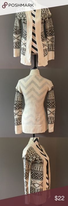 Knitted Mossimo Cardigan Knitted Mossimo Cardigan is fit, warm and has pockets! Color is cream and a slightly lighter brown than shown in photo. EUC Mossimo Supply Co Sweaters Cardigans
