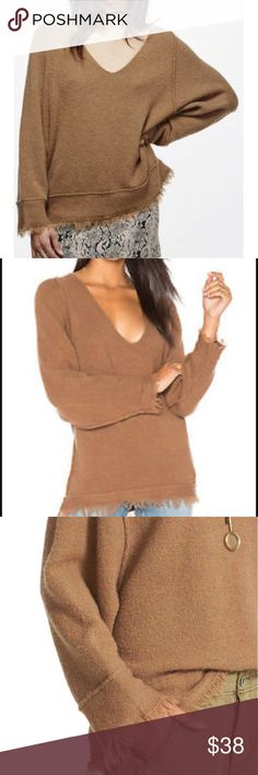 Free People Irresistible Fringe Trim Sweater A slouchy, oversized silhouette defines the comfy, boho inspired vibe of a cozy wool blend sweater styled with a deep V neckline and fluttery fringe trim along the cuffs and hems. Free People Sweaters V-Necks