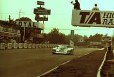 Stefan Bellof crossing the finish line at the Budweiser GT Mosport Aug 1984