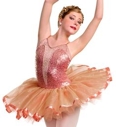 Curtain Call Costumes® - Everlasting Light Peach nylon/spandex and sequin poly/spandex leotard with stretch lace bodice panel and attached six row graduated glitter tulle and net tutu with ribbon trim and tulle panty ruffles. INCLUDES: rhinestone flower barrette (not shown). Made in the U.S.A. of imported fabric.  https://curtaincallcostumes.com/products/product-page-t.php?prodid=8488 For more information in Australia www.curtaincallcostumes.com.au