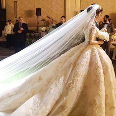 Bride in a couture gown by Michael Cinco                                                                                                                                                                                 More