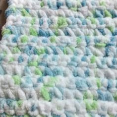 "$50. This beautiful blanket is hand crocheted by my mom. It is made out of the thickest/softest yarn I have ever felt. So soft to the touch. Great use as a snuggly blanket for your little one. It is made with beautiful blue, mint and white colors.   Blanket measurement is roughly 36"" x 36"".   Machine wash gentle cycle or hand wash. Lay flat to dry.   This blanket was made in a smoke free but very pet friendly home.   To purchase this item either leave email address below or check out my Etsy…"