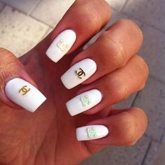 Simple white Chanel nails.