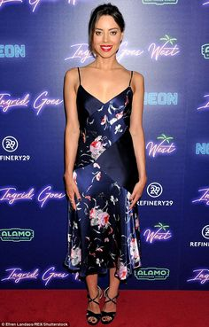 Smooth as silk! The Parks And Rec beauty oozed star-power at the screening where she showe...