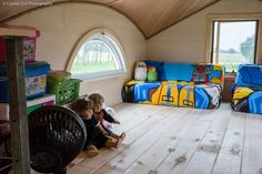 During the day, their beds fold up into little couches, which gives them lots of room to play with their toys!