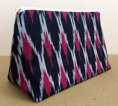 A personal favorite from my Etsy shop https://www.etsy.com/in-en/listing/270905989/red-black-and-white-ikat-print-cosmetics