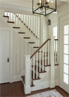 A classic entryway w/ very limited space; millwork & lighting (from windows & fixtures) adds beauty, interest & light -- Shingled River Retirement Cottage stairs Shingled River Cottage Cottage Staircase, Small Staircase, Entryway Stairs, Staircase Railings, House Stairs, Staircase Design, Staircase Ideas, Railing Ideas, Bannister
