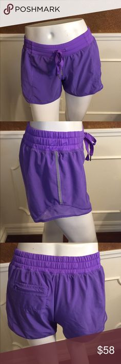 Lululemon Hotty Hot short Long These are NWOT.  This color is no longer offered.  They have a liner and a pocket in the back and a reflective strip on each side for running.  It is a gorgeous color.  I'm really sad to part with them.  The only reason they were washed is because I tried them on several times thinking I might keep them.  They are just too big  for me.  I wear a 2 and these are a 6.  I purchased them online. That was the only size available.  😢 Lululemon Shorts