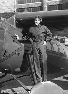Tragic: Amelia Earhart leans on the propeller on the right wing engine on her airplane. Ea...