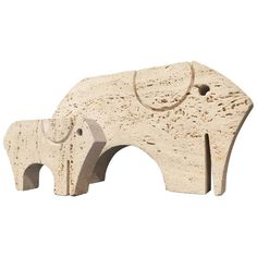 Pair of Carved Travertine Elephant Table Sculptures | From a unique collection of antique and modern sculptures at https://www.1stdibs.com/furniture/decorative-objects/sculptures/