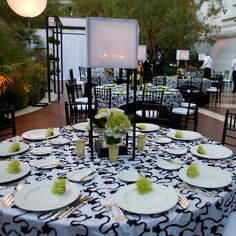 Black and white linens in a swirly baroque pattern inspired the tablescape details at a @Four Seasons Hotel Las Vegas reception.