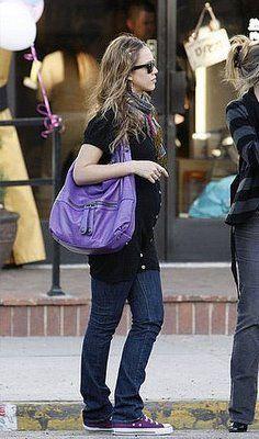 Jessica Alba shops in L.A. wearing  purple Converse  & toting a purple hobo handbag.