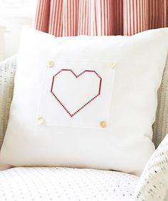 Add a simple cross-stitched patch to a plain cushion cover