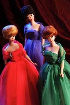 Halina gowns in jewel tones are modeled by bubblecut Barbies from the collection of Barry Sturgill.