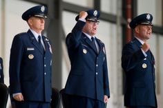 From left, 3rd Air Force Commander Lt. Gen. Timothy Ray sings the Air Force song with Brig. Gen. Jon Thomas, and Brig. Gen. Richard Moore at the end of the 86th Airlift Wing change-of-command ceremony at Ramstein Air Base, Germany, on Wednesday, Aug. 17, 2016. Moore succeeds Thomas as the wing's commander. (Michael B. Keller/Stars and Stripes)