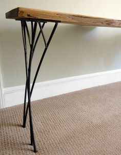 Wonderful organic branch pattern inspired steel legs. Custom made at Iron and Woodside