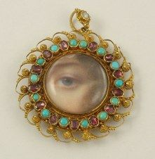Tiny turquoise, garnet and pearl eye portrait on ivory.