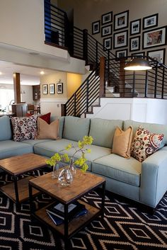 The Chic Technique: Oh my goodness, love it... The couch, the pillows, the rug, the tables. I would redo my living room to this if I could!