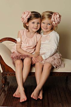 I adore these sisters' outfits, ruffles and flowers galore!