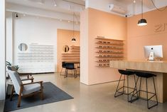 The Zita Optics interior is based on a simple colored border that frames a section of walls and optically unifies the interior into a single unit. Self-leveling cement with natural coloration […] Eyewear Shop, Oak Desk, Cafe Shop, Black Furniture, Bratislava, Store Design, Wall Colors, Interior And Exterior, Architecture Design