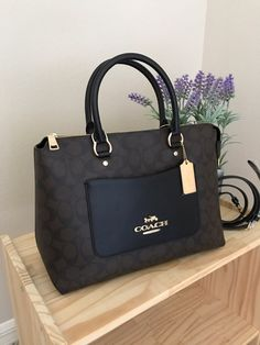 COACH Signature Emma Satchel Black/Brown and gold hardware **Brand new with tags** Approximate Measurements: 12 (L) x 9 (H) x 5 (W) MEDIUM Handles with 4 Detachable strap with 22 drop