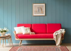 red couch. blue wall.