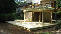 After Photo:  We gave this customers upper deck a facelift a couple of years ago.  A bad storm made the decision to replace the lower deck easier.  We added a pergola to shade the lower deck