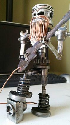 Image result for sculpture using engine parts of drag lights
